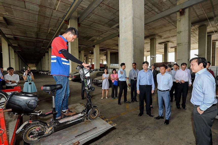 At 92kg, the e-scooter is the heaviest seized to date and is way above the maximum allowable weight of 20kg. PHOTO: FACEBOOK/KHAW BOON WAN