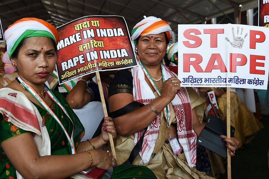 Women hold placards in reaction to rape cases in India during a rally in New Delhi on April 29, 2018.