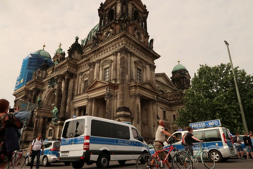 Police vehicles are seen outside the Berliner Dom after a German policeman shot a man there on June 3, 2018.