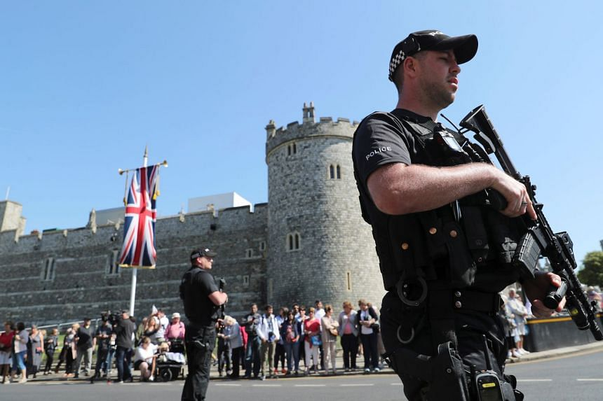 Armed police officers patrolling ahead of the changing of the guard ceremony in Windsor, Britain, on May 15, 2018.