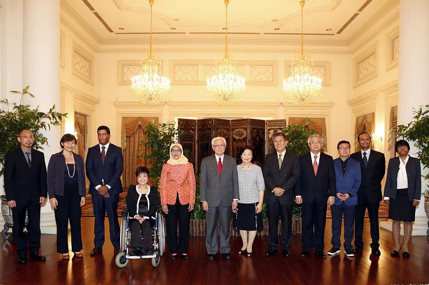 Then President Tony Tan Keng Yam and his wife Mary (centre) and then Parliament Speaker Halimah Yacob (fifth from left) together with NMPs (from left) Randolph Tan, Kuik Shiao-Yin, Ganesh Rajaram, Chia Yong Yong, Azmoon Ahmad, Thomas Chua, Kok Heng L