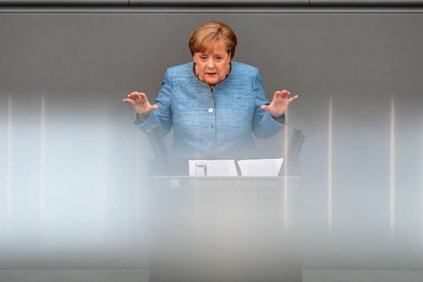 German Chancellor Angela Merkel gives a speech on her government's budget policy at the Bundestag (lower house of parliament) in Berlin on May 16, 2018.