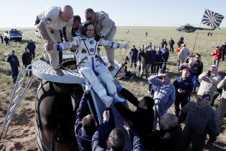 Ground personnel help International Space Station crew member Anton Shkaplerov of Russia to get out of the Soyuz MS-07 space capsule shortly after landing in a remote area outside the town of Dzhezkazgan (Zhezkazgan), Kazakhstan on June 3, 2018.