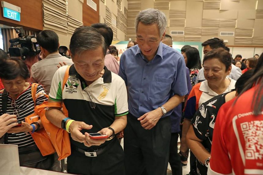 PM Lee Hsien Loong stressed the importance of not leaving behind less tech-savvy Singaporeans as the nation moves towards e-payments.