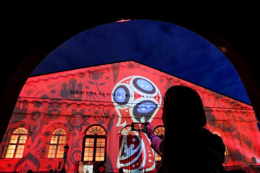 A preview of a World Cup laser show in Moscow. Singtel's Cast app provides full coverage of the Finals on mobile devices.