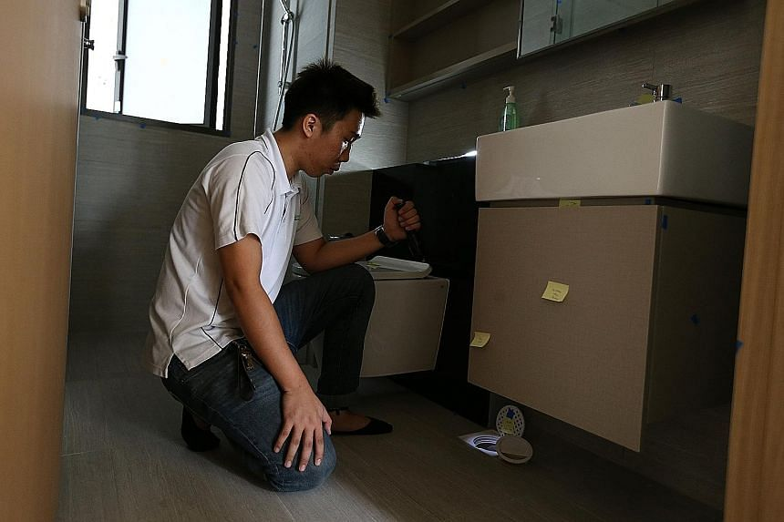 Defect inspectors conduct a number of checks, as shown by Advance Inspection's lead inspector Joelson Sim. From top: Mr Sim demonstrating the use of a spirit level to check the gradient of the floor. He checks the drainage for any debris that might l