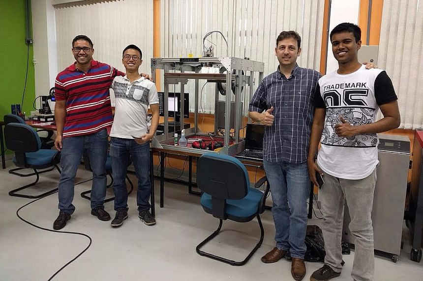 Mr Mohsin Ahamed (right) with his colleagues at the Sao Paulo laboratory where he did a three-month internship.