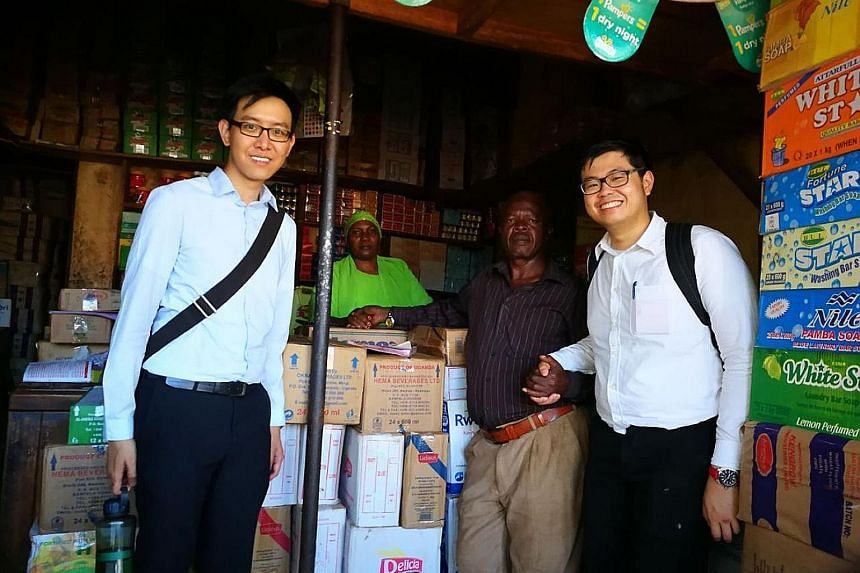 Mr Tan Rui Feng (right) with sellers at a local retailer he visited during his internship stint in Uganda. The Singapore Management University student spent 10 weeks from May last year at a consumer goods firm there.