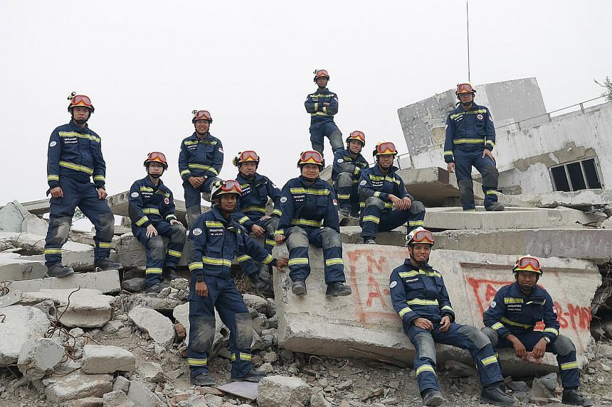 The Singapore Civil Defence Force participants at the Senior Training Course for Urban Search and Rescue in Beijing last month. One of the key objectives of the course, which ran from May 7 to 14, was to foster cooperation and share disaster relief t