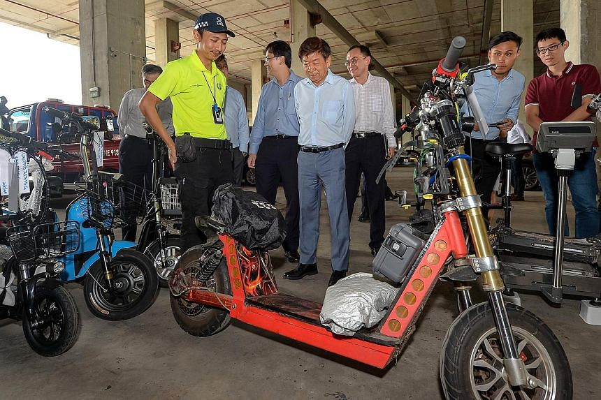 Transport Minister Khaw Boon Wan taking a look at the seized 92kg e-scooter during a visit to the LTA pound. The maximum weight allowed is 20kg.