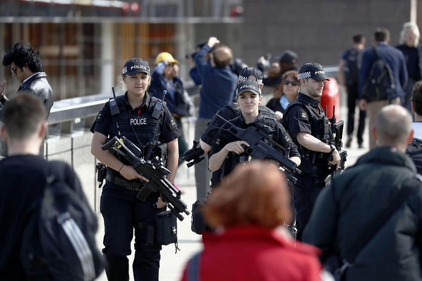 File photo showing armed police officers on patrol on London Bridge in Britain, on June 7, 2017.
