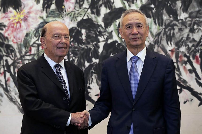 US Commerce Secretary Wilbur Ross (left) shakes hands with Chinese Vice Premier Liu He at the Diaoyutai State Guesthouse in Beijing, China, on June 3, 2018.