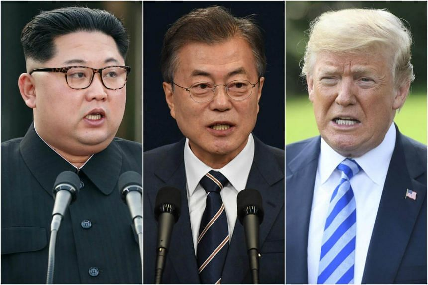 A South Korean official said no decision has been made yet on whether President Moon Jae In (centre) will fly in to join Kim Jong Un (left) and Donald Trump for the June 12 Singapore Summit.