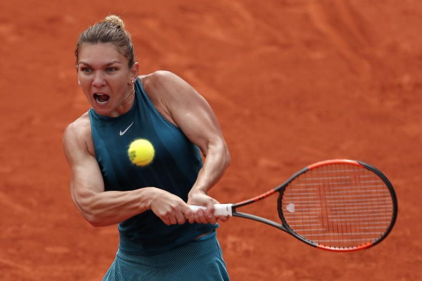 Simona Halep of Romania (above) plays Elise Mertens of Belgium during their French Open quarter-finals match in Paris on June 4, 2018.