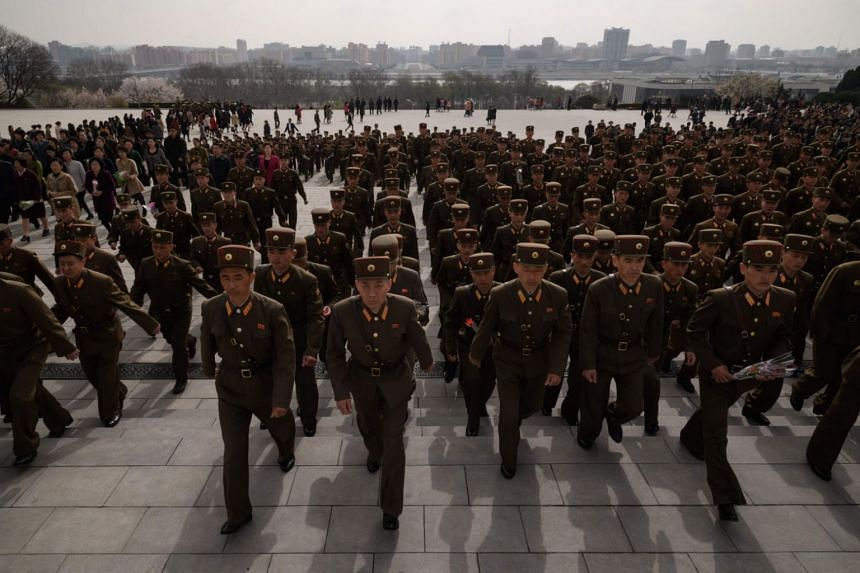 File photo showing North Korean soldiers paying their respects before the statues of late North Korean leaders Kim Il Sung and Kim Jong Il, at Mansu hill in Pyongyang, on April 15, 2018.