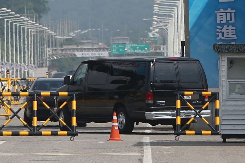 Vehicles carrying a US delegation across a border bridge in Paju, South Korea, on June 4, 2018, on their way to the truce village of Panmunjom.