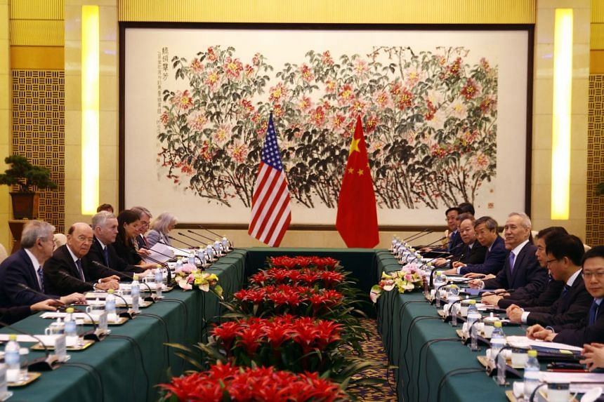 US Commerce Secretary Wilbur Ross and Chinese Vice Premier Liu He, along with their delegation of officials, attending a meeting at the Diaoyutai State Guesthouse in Beijing, China, on June 2018.