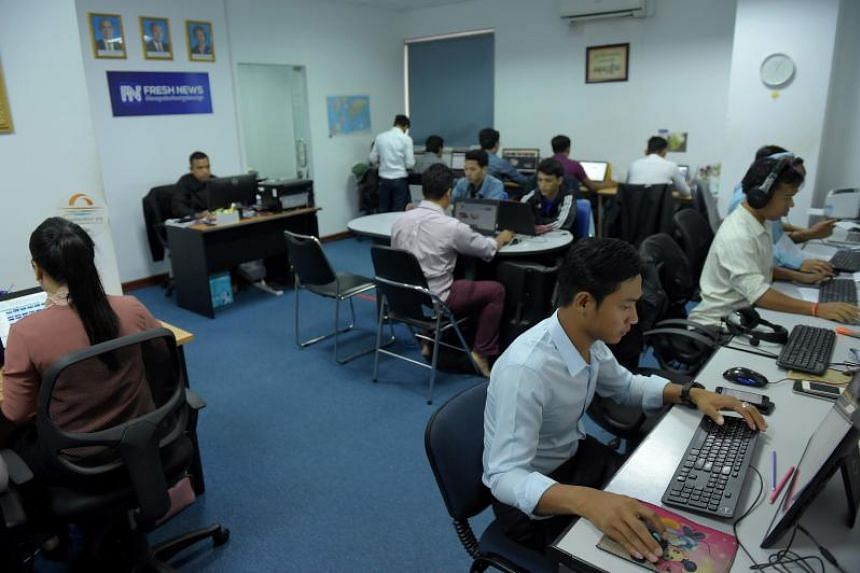 Staff members of Cambodian online news outlet Fresh News working in their newsroom in Phnom Penh on May 21, 2018.
