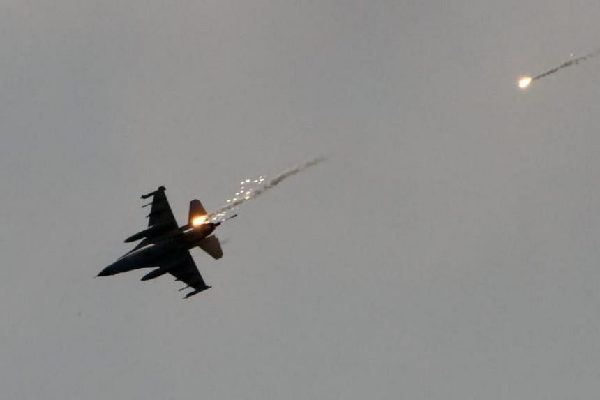 An F-16 fighter jet launches flares during a drill above the sea near the Suao navy harbour in Yilan, Taiwan, on April 13, 2018.