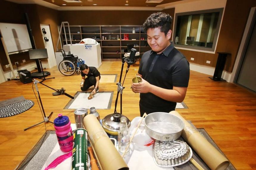 Syahrul Syadzwan (front) and Luqas Yue, Diploma in Sonic Arts Year 2 students, recording a sound demo with everyday objects in the Foley Arts Studio.