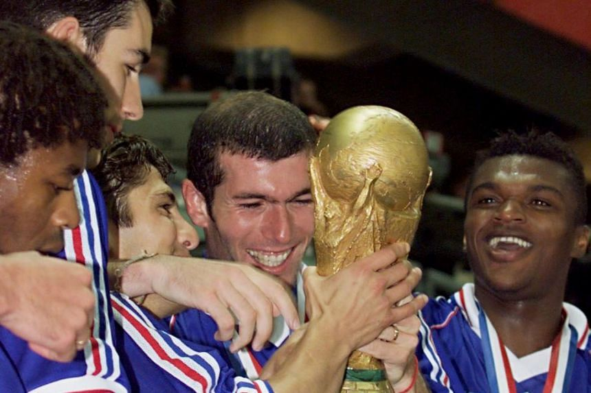 "Former French player Zinedine Zidane (holding trophy), with team-mates (from left) Bernard Diomede, Robert Pires, Bixente Lizarazu and Marcel Desailly, said winning the 1998 World Cup is ""the most beautiful thing"" to happen to him."
