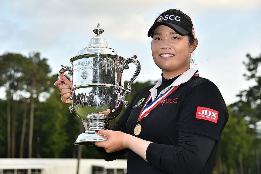 Thailand's Ariya Jutanugarn with her US Women's Open trophy after beating South Korea's Kim Hyo Joo in the fourth play-off hole at the Shoal Creek, Alabama course on Sunday.