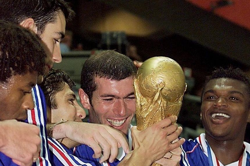 Zinedine Zidane holding the World Cup with team-mates (from left) Bernard Diomede, Robert Pires, Bixente Lizarazu and Marcel Desailly, after France beat Brazil 3-0 in the final in Paris in July 1998.