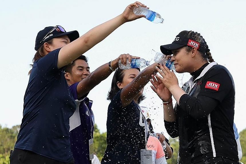 Ariya is doused with water by members of her entourage in celebration of her second Major title victory.