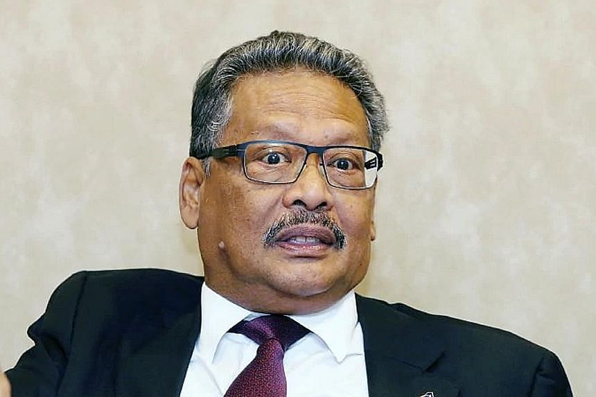 The selection of constitutional lawyer Tommy Thomas (top), a non-Malay, has not gone down well with the King. Current Attorney-General Mohamed Apandi Ali (above) has been put on garden leave.