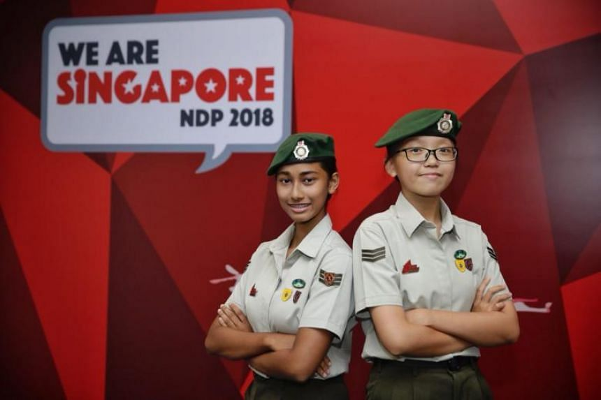 Christchurch Secondary School National Cadet Corps Precision Drills Squad's Nur Mufidah Selamat (left) and Vicky Soh, both 15, are first-time participants in the National Day Parade.