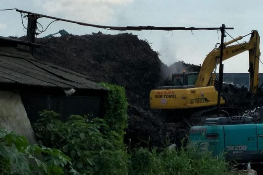 The fire involved a large pile of wood waste, measuring approximately two football fields in area and 15m high. ST understands that the fire was located within the farm Malaysian Feedmills.