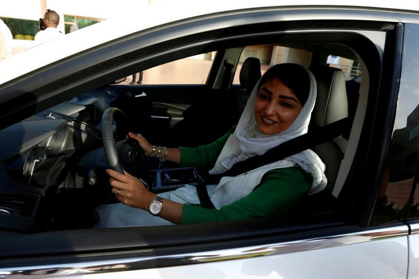 A Saudi woman sits in a car during a driving training at a university in Jeddah, Saudi Arabia, March 7, 2018.