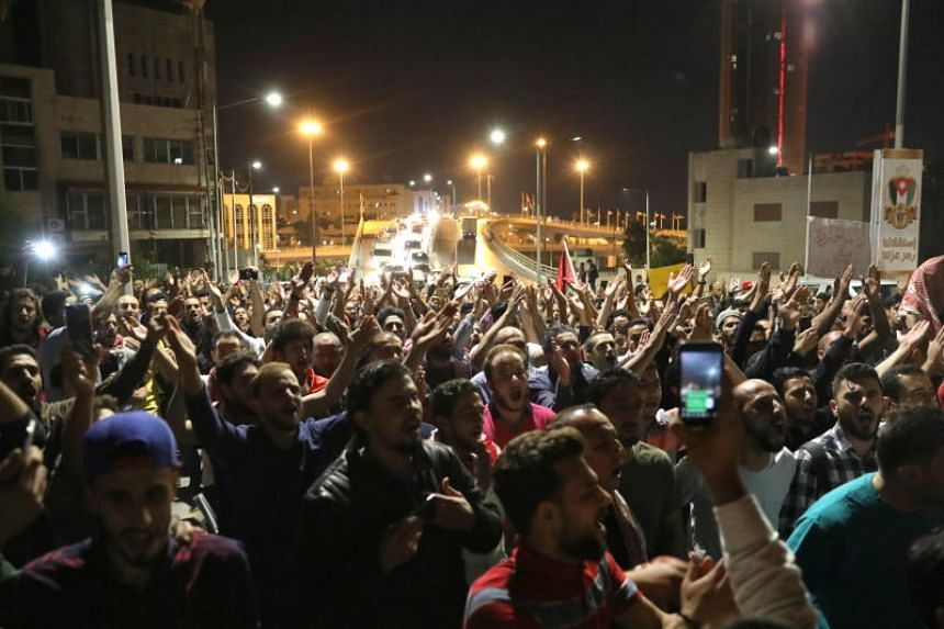 Jordanians shout slogans during a demonstration against the newly proposed income tax reforms and hike in petrol tax in Amman, Jordan, on June 3, 2018.