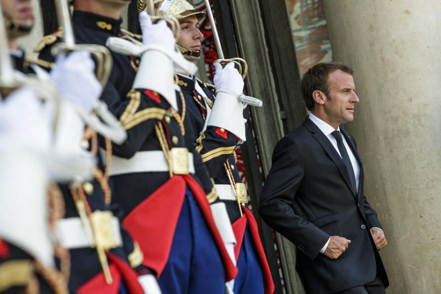 French president Emmanuel Macron waits to welcome Niger President Mahamadou Issoufou (not pictured) prior to their meeting at Elysee palace in Paris, France, on June 4, 2016.