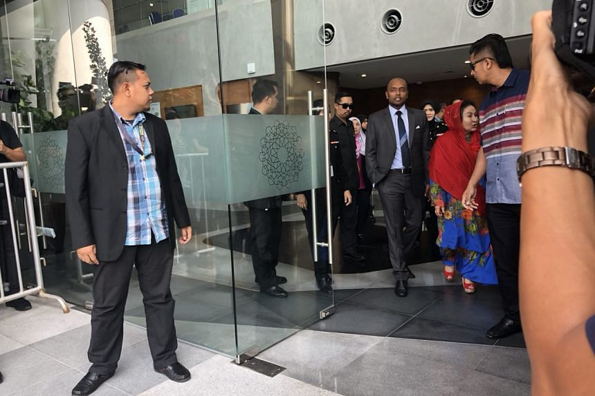 Madam Rosmah Mansor leaving the Malaysian anti-graft agency after five hours of questioning on 1MDB unit SRC International.