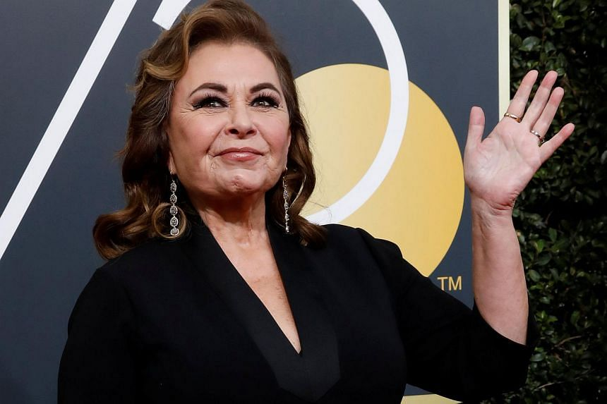 Actress Roseanne Barr waves on her arrival to the 75th Golden Globe Awards in Beverly Hills, California, on Jan 7, 2018.