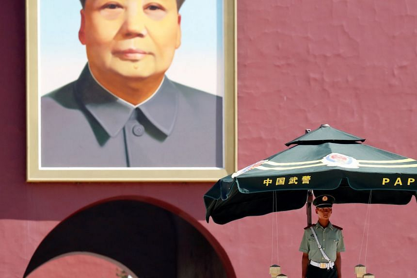 A paramilitary policeman keeps watch underneath the portrait of former Chinese Chairman Mao Zedong in Beijing's Tiananmen Square, China, on June 4, 2018.