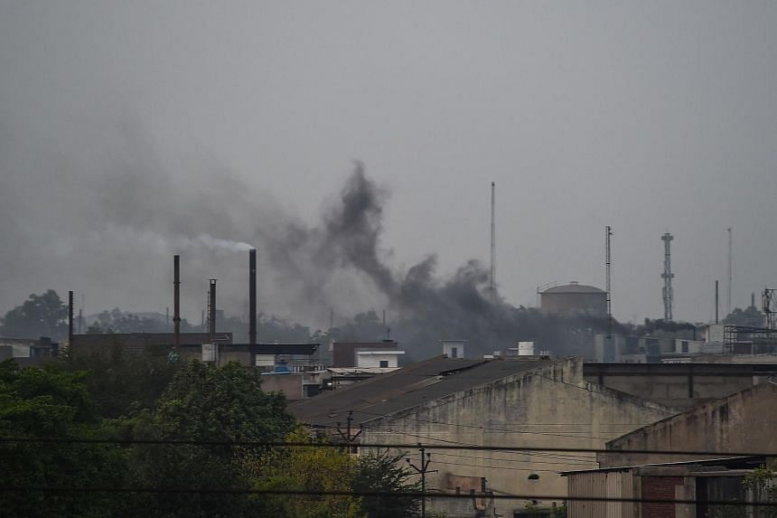 Smoke rises from chimneys in an industrial area in the Indian city of Kanpur, on May 31, 2018.