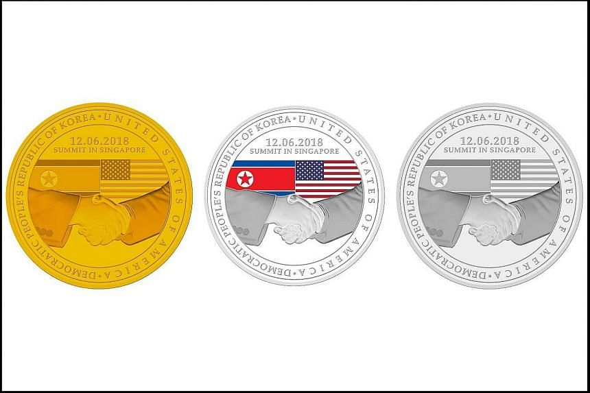 Commemorative gold, silver and base-metal medallions unveiled by the Singapore Mint to mark the Singapore Summit on June 12.