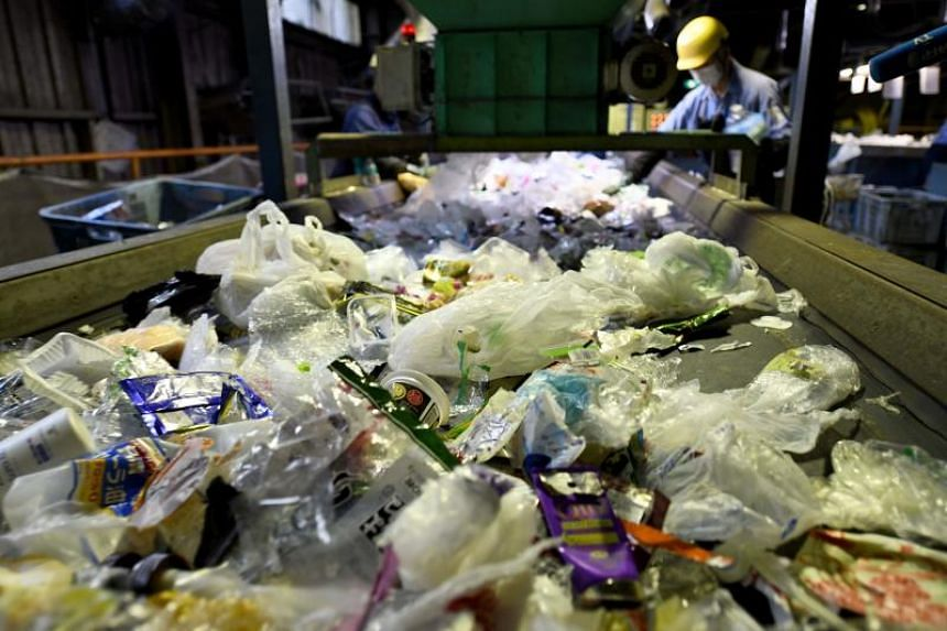 Some 10 tonnes of recyclable plastics are brought in every day to be processed at the Ichikawa Kankyo Engineering centre, where workers hover over conveyor belts removing any stray items or contaminants.