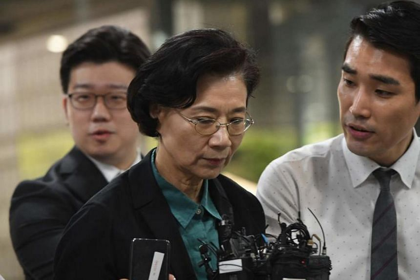 Lee Myung Hee (centre), wife of Korean Air chairman Cho Yang Ho, arrives for questioning on her arrest warrant at the Seoul Central District Court in Seoul, on June 4, 2018.