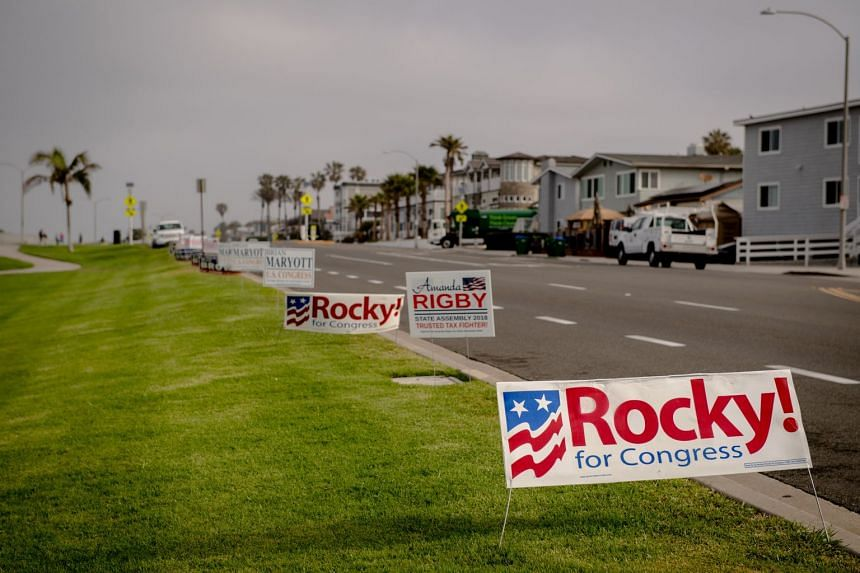 Signs advertising candidates for Congress on the side of the road in Carlsbad, California, on June 4, 2018.