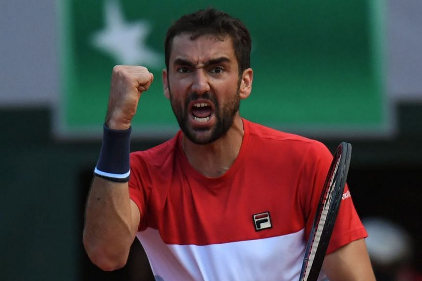 Croatia's Marin Cilic celebrates after his victory during his men's singles fourth round match against Italy's Fabio Fognini (not pictured) on day nine of The Roland Garros 2018 French Open tennis tournament in Paris on June 4, 2018.