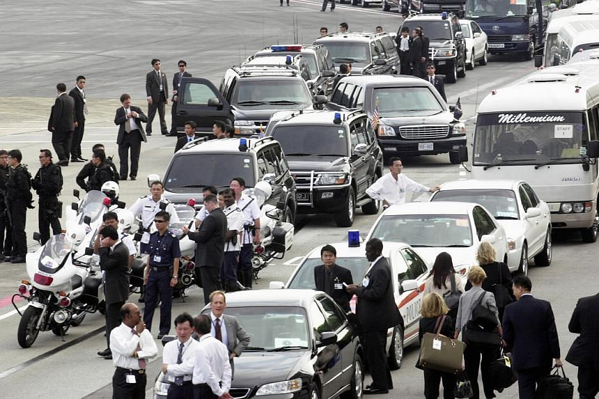 People waiting for the arrival of US President George Bush and Mrs Bush at Paya Lebar Air Base for a two-day official visit in Singapore in October 2003.