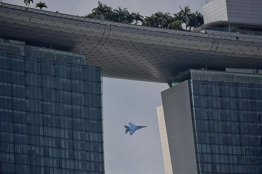 The Republic of Singapore Air Force (RSAF) flew an F-15 fighter jet yesterday to give reporters a preview of this year's aerial display for the National Day Parade. The jet is painted blue with the number 50 on its side to celebrate the RSAF's golden