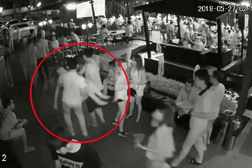 CCTV footage showing the unconscious woman being carried out of the pub by the men.