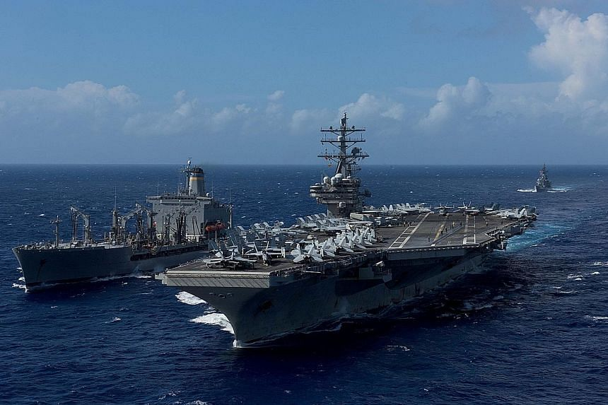 The USS Ronald Reagan in waters off Okinawa, about 700km from Taiwan, last October. A US aircraft carrier last transited the Taiwan Strait in 2007. Some US military officials believe another carrier transit is overdue.
