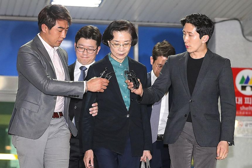 Lee Myung Hee, the wife of Korean Air chairman Cho Yang Ho, leaving a police station in Seoul yesterday, after a court denied a police request to detain her over charges of verbal and physical violence against chauffeurs and other people under her co