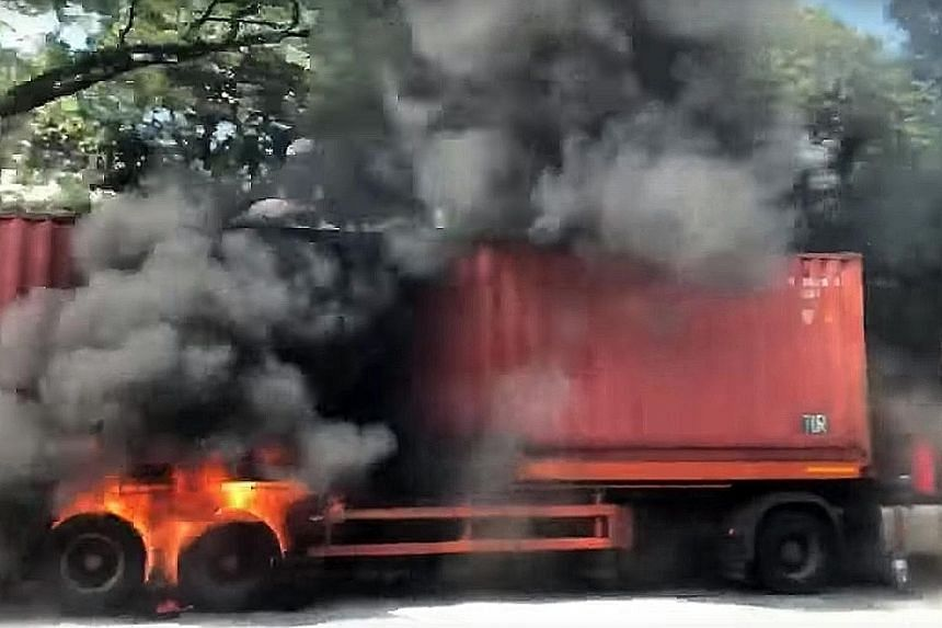 Photos sent to The Straits Times showed plumes of black smoke rising from the trailer. The tyres near the rear were seen to be in flames.