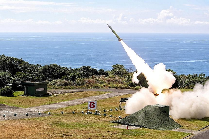 A surface-to-air Patriot missile being fired during the annual Han Kuang military drills in Pingtung, Taiwan, yesterday. According to media reports, the exercise was to test Taiwan's defence capabilities in a simulated invasion by China's People's Li